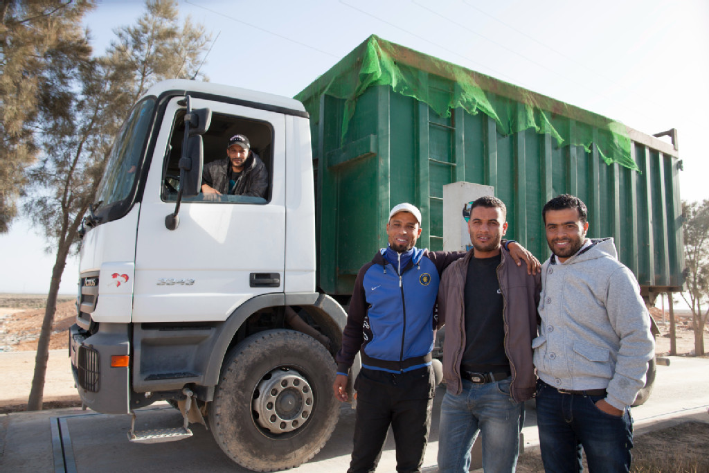 People standing in front of a truck