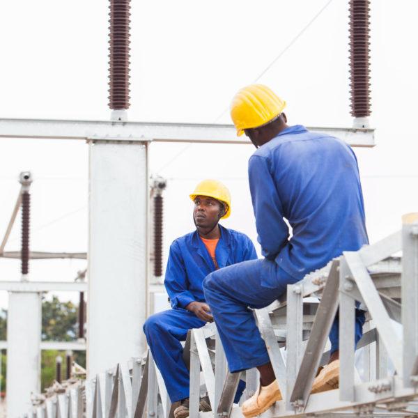 Workers on a power pole in Rwanda